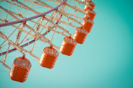 Ferris wheel on blue sky - Vintage tone