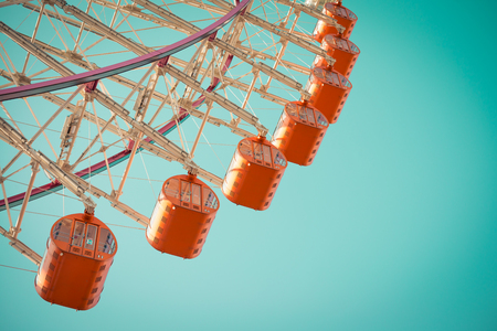 Ferris wheel on blue sky - Vintage tone