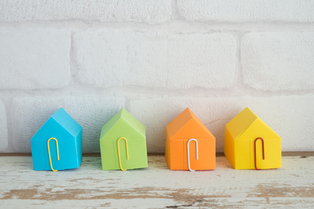 Colorful paper house on wooden table background with free copy space - ideas house real estate concept Banco de Imagens