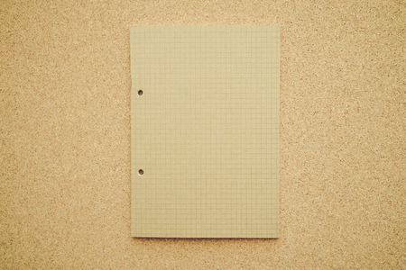 Blank empty notepad on cork table