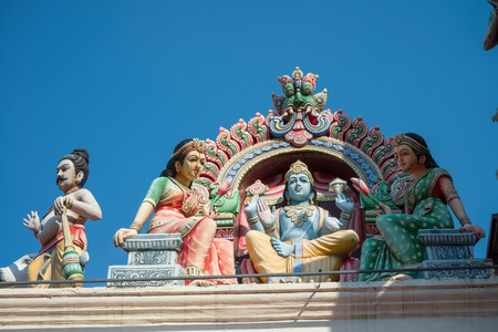 Detail of the Sri Mariamman Hindu Temple, little india, Chinatown in Singapore with blue sky