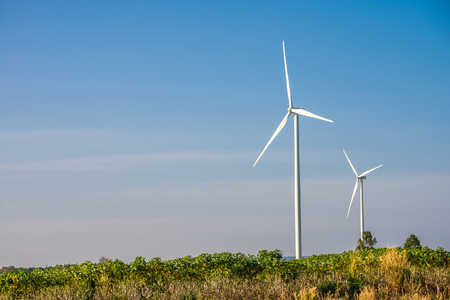 Wind turbines generating electricity with blue sky - energy conservation concept Archivio Fotografico