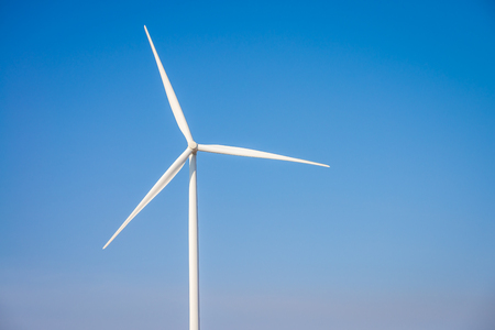 Wind turbines generating electricity with blue sky - energy conservation concept Stock Photo