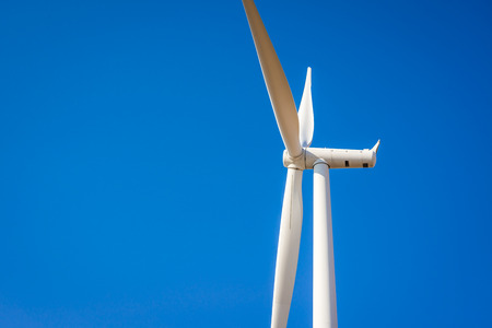 Wind turbines generating electricity with blue sky - energy conservation concept Banque d'images