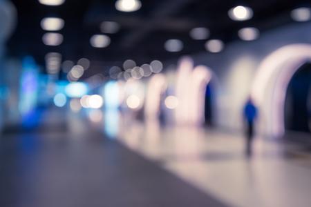 Abstract blur people walking in hallway corridor background Banco de Imagens