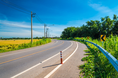 Beautiful empty curved country road, Thailand
