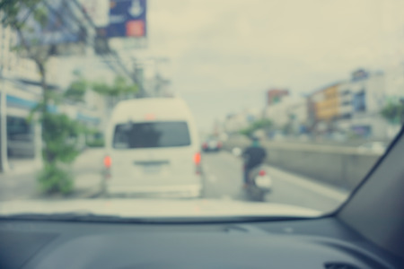 Abstract blur traffic from inside car view background - Vintage filter effect