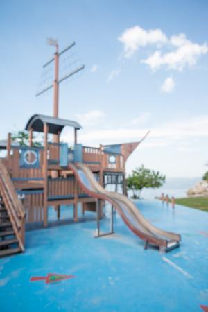 Abstract blur seaside children playground in city park background