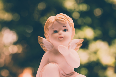 Angelic cupid statue - vintage retro effect style picture