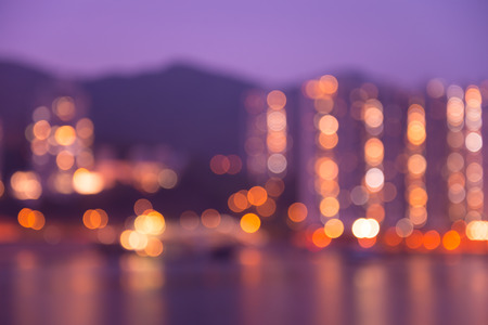 Abstract blur seaside cityscape in twilight evening with reflection background