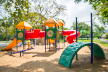 Abstract blur children playground in city park background Stock Photo