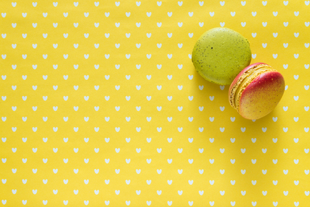 Colorful france macarons on yellow background Reklamní fotografie