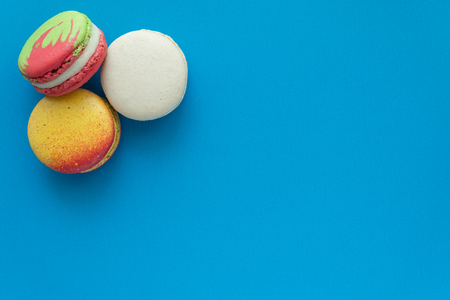 Colorful france macarons on blue background