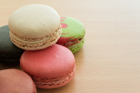 Colorful france macarons on wooden background -  selective focus