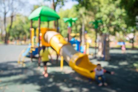 Abstract blur child in children playground in city park background