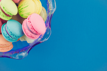 Colorful france macarons on blue background - Retro filter effect