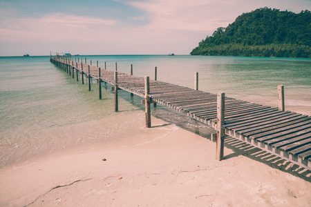 Long wooden bridge in beautiful tropical island beach Koh Kood, Trat Thailand - Vintage filter effect