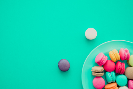 Colorful france macarons on blue background - Retro tone Reklamní fotografie