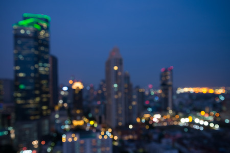 Defocused modern cityscape at night light background, blur urban skyscraper landscape 版權商用圖片