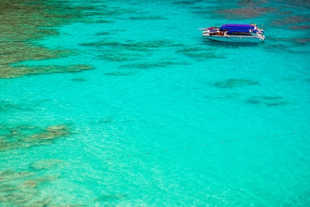 Boats on beautiful clear ocean Similan island at Andaman sea in southern Thailand Stock Photo