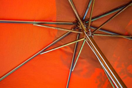 Red beach umbrella in resort Standard-Bild - 102807281