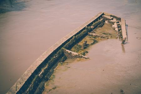 Old wooden shipwreck in Chao Phraya river, Bangkok Thailand - Vintage effect style Standard-Bild - 102807292