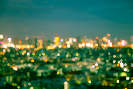 Defocused cityscape at night light background - Vintage effect style