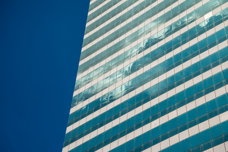 Exterior of glass office building and blue sky Standard-Bild - 102809411