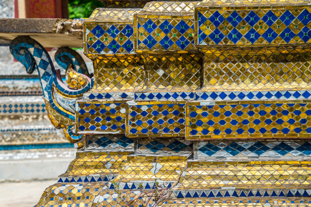 Old colorful thai style mosaic background on temple wall structure Standard-Bild - 102836660
