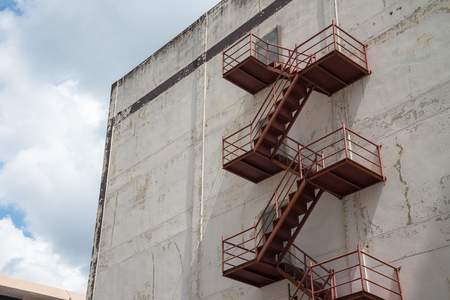 Old Architectural Building exterior of steel staircase Standard-Bild - 102809424
