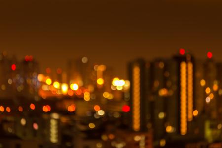 Defocused cityscape at night light golden luxury background Standard-Bild - 102836771
