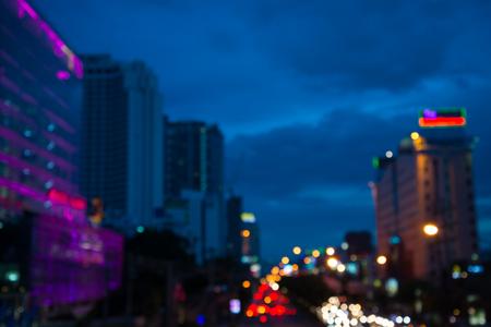 The evening twilight traffic in Bangkok city lights motion blur Standard-Bild - 102837475