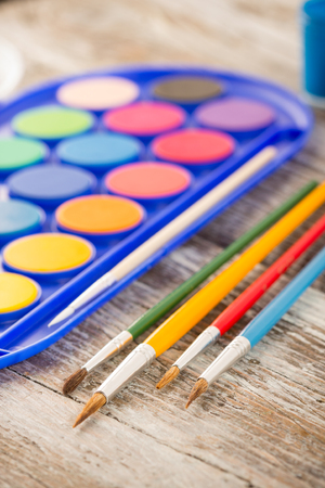 special education: special painting tools on wooden background, education tools for schools Stock Photo