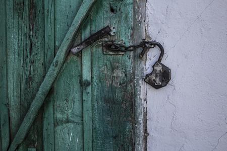 Unlocked old wooden door view 1
