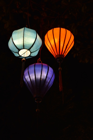 Brightly colored lanterns at night at the port city of Hoi An in Vietnam, Asia Stock Photo