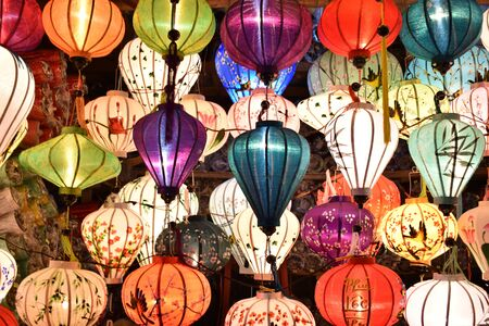 Brightly colored lanterns on a local market at the port city of Hoi An in Vietnam, Asia Stock Photo
