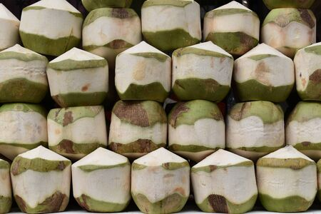 Closeup of fresh young coconut drink on a local street food market (chatuchak market) in Thailand, Asia Stock Photo