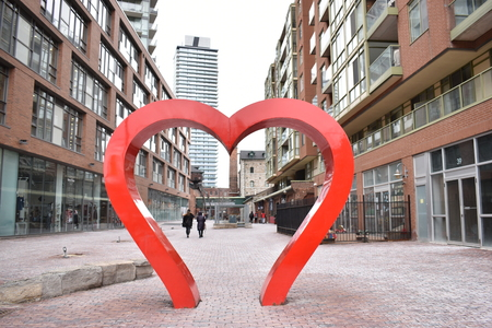 Famous Distillery District with a big heart sculpture in Toronto, Canada