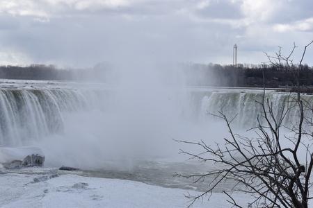 Beautiful gigantic frozen Horseshoe Niagara Falls on a frozen spring day at Niagara Falls in Ontario, Canada
