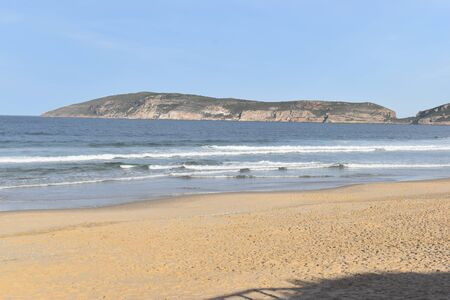 Wonderful beach with Robberg Nature Reserve in background at Plettenberg Bay, South Africa 스톡 콘텐츠
