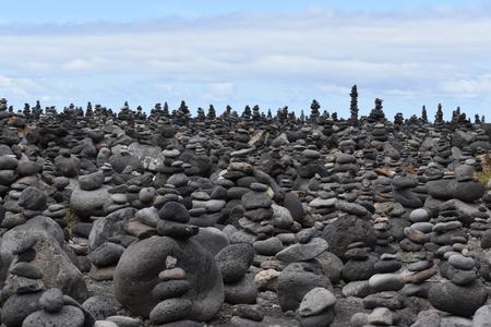 Stacked stone figures on the beach playa jardin at Tenerife in Puerto de la Cruz in Europe Stock Photo