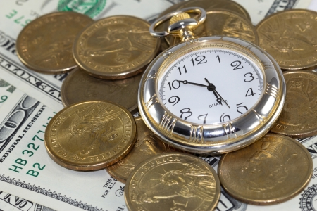 Golden watch around U S  coins  time is money concept  Stock Photo - 16007125