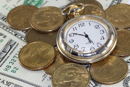 Golden watch around U S  coins  time is money concept Stock Photo - 16007125