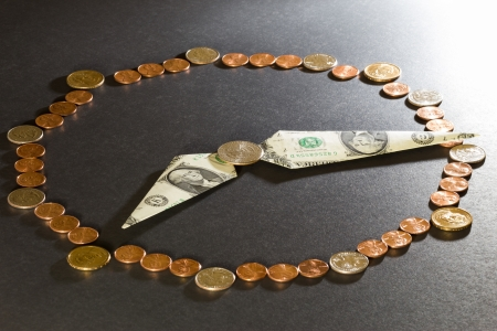 Clock made from US coins and dollars  time is money concept