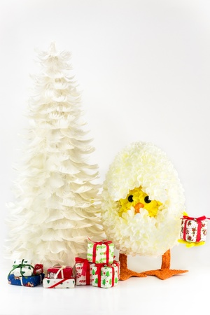 Close Up of isolated feather Christmas tree with cute chick inside the egg on white background Stock Photo - 16177246