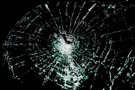 sabotage: Close up of broken glass on a black background Stock Photo