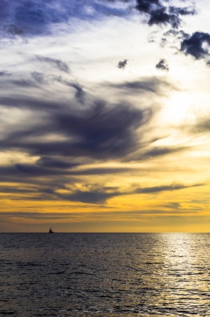 dramatic dark cloudy sunset over the ocean