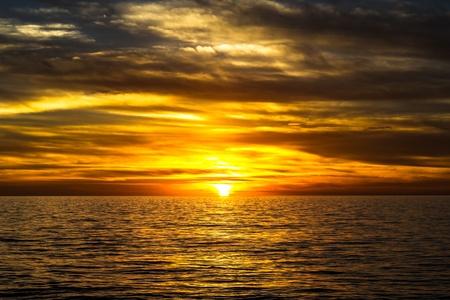 dramatic golden sunset over the ocean