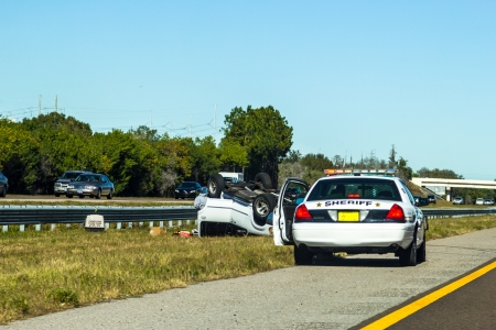 police car arrives at a car accident on Dec 22, 2012 on hwy 75  in Florida, USA Editorial