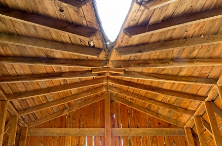 attic: the inside view of a damaged wooden roof on an abandoned house Stock Photo